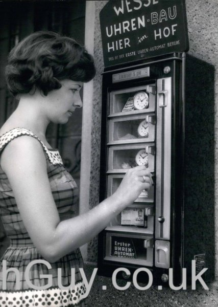 Jul. 16, 1963 - One can now acquire an alarm or clock on the street in Berlin if you just have the 5 marks on hand. Having been able to buy just about every kind of food, drinks, cosmetics, and other small everyday objects from machines, this clock vending machine should be a help to all Berliners who, after normal shops close, may need a clock. Now that s customer service. If vehicles were not so big it might be possible to buy them out of machines. PUBLICATIONxINxGERxONLY - ZUMAk09JUL 16 1963 One CAN Now to Alarm or Clock ON The Street in Berlin If You Just have The 5 Marks ON Hand Having been Able to Buy Just About Every Child of Food Drinks Cosmetics and Other Small everyday Objects from Machines This Clock vending Machine should Be a Help to All Berliner Who After Normal Shops Close May Need a Clock Now Thatcher S Customer Service If VEHICLES Were Not as Big IT Might Be possible to Buy THEM out of Machines PUBLICATIONxINxGERxONLY ZUMAk09